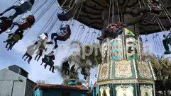 Amusement Park, Art, Blue Sky, Building, Child, Cloud, Column, Countryside, Hammock, Hanging-stage, House, Human, Nature, Palm Tree, Sun Light, Swinging, Tar, Tree, Wind
