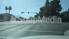 Asphalt, Automobile, Building, Car, City, Coupe, Downtown, Freeway, Grand Theft Auto, Highway, Housing, Human, Intersection, Land, Light, Metropolis, Nature, Outdoors, Path, Pedestrian, Person, Plant, Road, Sports Car, Street, Tarmac, Town, Traffic Light, Transportation