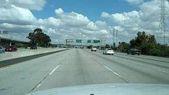 Automobile, Bridge, Building, Car, City, Freeway, Highway, Human, Metropolis, Overpass, Person, Road, Sedan, Street, Town, Transportation, Urban, Vehicle