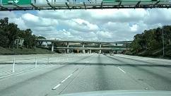Airport, Airport Terminal, Architecture, Automobile, Bridge, Building, Car, City, Freeway, Highway, Human, Lighting, Metropolis, Overpass, Pedestrian, Person, Road, Sedan, Street, Terminal, Town, Transportation, Urban