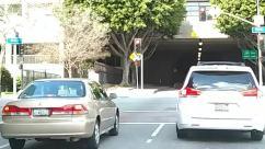 Asphalt, Automobile, Building, Bumper, Car, City, Coupe, Label, License Plate, Light, Parking, Parking Lot, Pedestrian, Photo, Photography, Road, Sedan, Sports Car, Tarmac, Text, Town, Traffic Light, Transportation, Urban, Vehicle