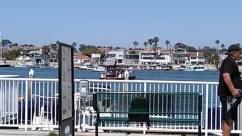 Person, Human, Port, Waterfront, Water, Dock, Pier, Harbor, Urban, Town, City, Building, Transportation, Vehicle, Metropolis