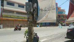 Person, Human, Vehicle, Transportation, Car, Automobile, Motorcycle, Advertisement, Poster, Billboard, Machine, Wheel, Tree, Plant, Path