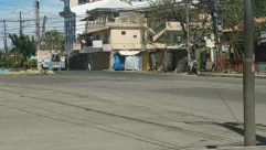 Person, Human, Urban, Building, Road, Street, Town, City, Bicycle, Transportation, Vehicle, Bike, Apparel, Clothing, Shorts