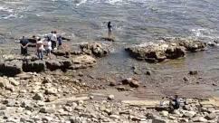 Person, Water, Outdoors, Rock, Nature, Sea, Ocean, Adventure, Leisure Activities, Urban, Shoreline, Vacation, Building, Coast, Tourist