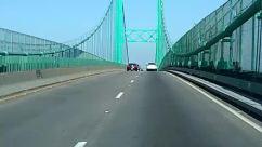 Road, Bridge, Building, Freeway, Person, Transportation, Vehicle, Motorcycle, Automobile, Car, Highway, Moped, Motor Scooter, Vespa, Suspension Bridge
