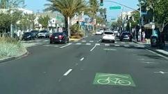 Road, Asphalt, Tarmac, Person, Intersection, Zebra Crossing, Vehicle, Transportation, Automobile, Car, City, Building, Urban, Town, Street