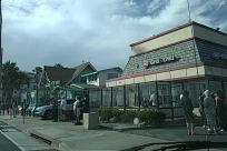 Person, Vehicle, Car, Automobile, Transportation, Pedestrian, Building, Urban, Plant, Tree, Neighborhood, Palm Tree, Arecaceae, Housing, Town