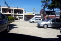 Automobile, Vehicle, Car, Wheel, Road, Tire, Urban, Building, City, Town, Car Wheel, Sedan, Police Car, Intersection, Street