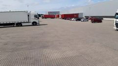 Vehicle, Truck, Automobile, Car, Van, Parking, Parking Lot, Path, Moving Van, Trailer Truck, Wheel, Walkway, Cargo, Floor, Car Dealership