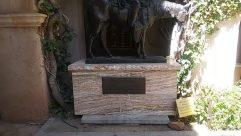 Plaque, Art, Sculpture, Statue, Monument, Horse, Plant, Pants, Wood, Slate, Painting, Coat, Footwear, Letterbox, Mailbox