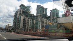Road, Automobile, Car, Vehicle, Freeway, Building, Town, City, High Rise, Street, Highway, Bus, Metropolis, Apartment Building, Office Building