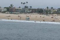 Water, Ocean, Sea, Shoreline, Building, Coast, Bird, Beach, Vehicle, Waterfront, People, Vacation, Watercraft, Vessel, Landscape