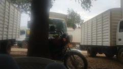 Truck, Vehicle, Wheel, Motorcycle, Automobile, Car, Van, Helmet, Motor, Road, Bus, Tire, Plant, Moving Van, Vegetation