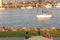 Vehicle, Vessel, Watercraft, Boat, Water, Sailboat, Waterfront, Building, People, City, Town, Marina, Rowboat, Rock, Yacht