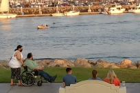 Chair, Furniture, Wheelchair, Shorts, Vehicle, People, Water, Waterfront, Building, Boat, Vacation, Rowboat, Plant, Dock, Pier