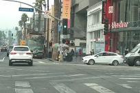 Road, Vehicle, Automobile, Car, Traffic Light, Light, Bus, City, Street, Town, Building, Truck, Tour Bus, Neighborhood, Intersection