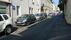 Vehicle, Automobile, Car, Street, Building, City, Town, Road, Sedan, Parking, Parking Lot, Bumper, Path, Neighborhood, Spoke
