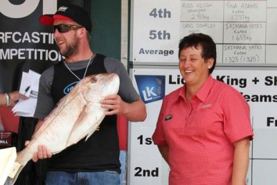 Shaun Healy with Chris from Farmlands. Shaun from Murupara won $500 for a 7.542kg fish.