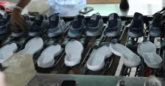 Shoe factory video- outsole glueing