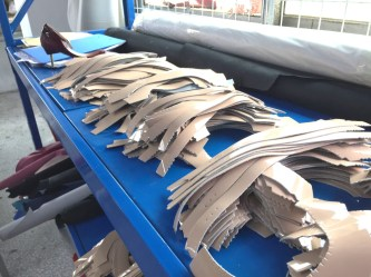 Cut shoe parts are carefully stacked