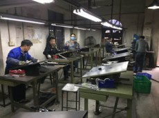 A busy shoe cutting die factory
