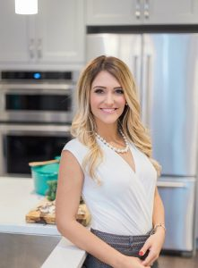 Nicole from Nic & Nat, the Sneaky Mommies Food Blog, in the kitchen