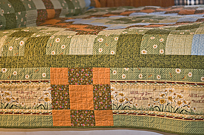 Quilt on the bed including border and binding
