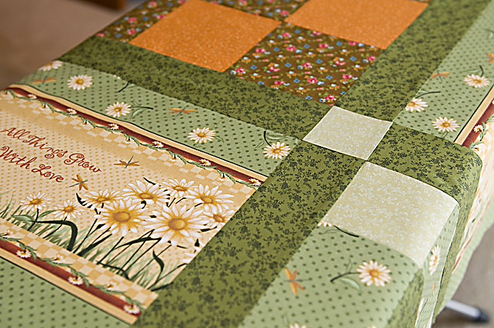 Part of quilt on the ironing board