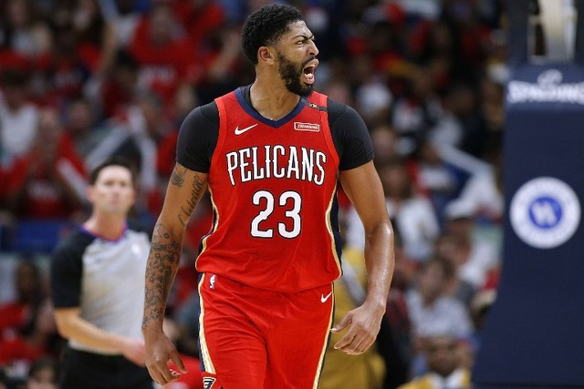NEW ORLEANS, LA - OCTOBER 19: Anthony Davis #23 of the New Orleans Pelicans reacts during the first half against the Sacramento Kings at the Smoothie King Center on October 19, 2018 in New Orleans, Louisiana. NOTE TO USER: User expressly acknowledges and agrees that, by downloading and or using this photograph, User is consenting to the terms and conditions of the Getty Images License Agreement.   Jonathan Bachman/Getty Images/AFP