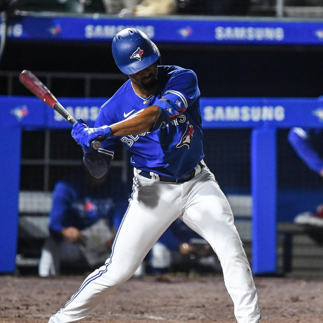 Blue Jays player Marcus Semien swings his bat on route to a homerun