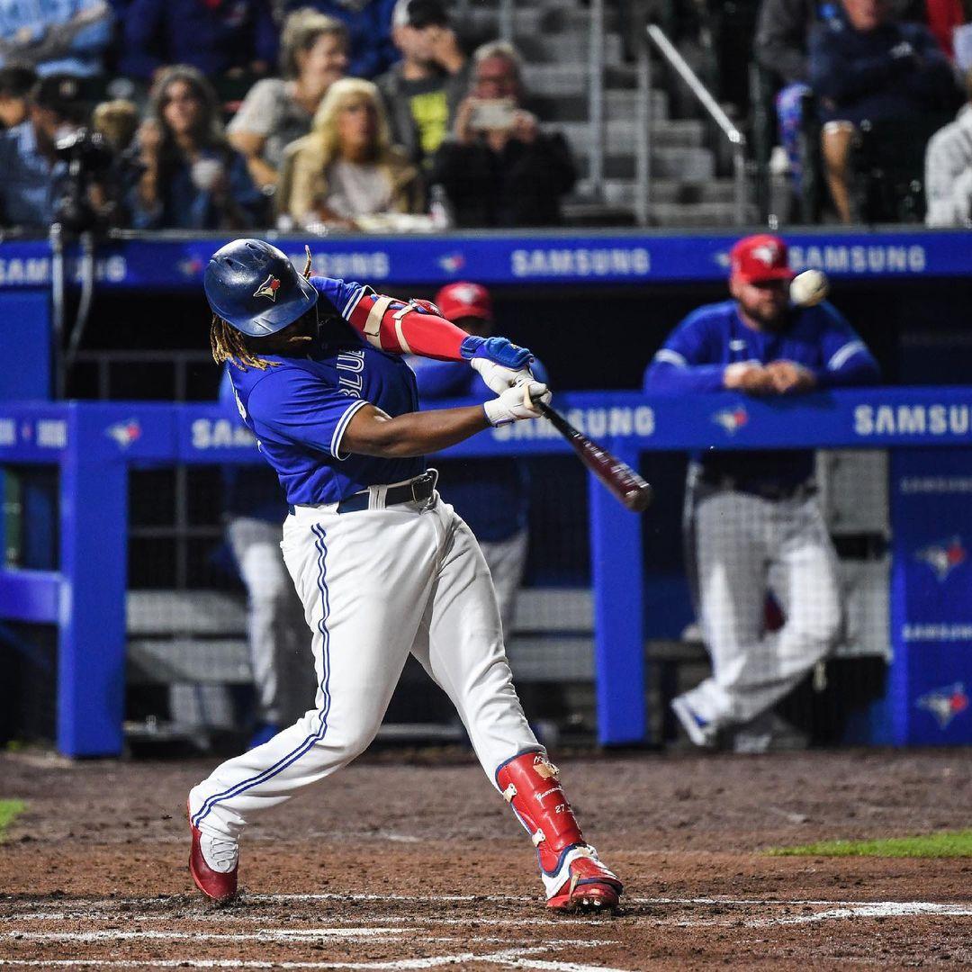 Blue Jays player Vladdy Guerrero Jr. follows through to hit a home run