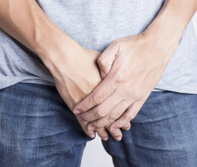 Man Holding Crotch