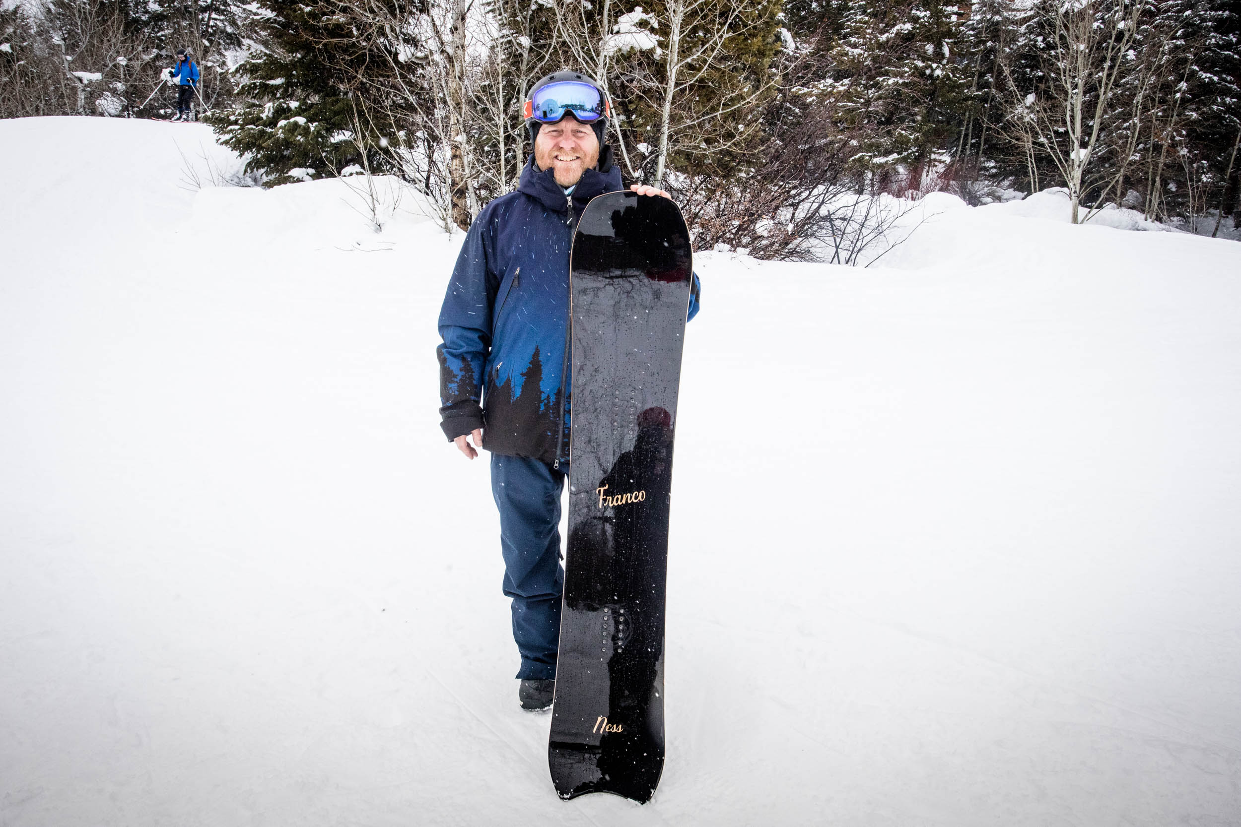 Custom snowboard builder and Franco Snowshapes founder, Mikey Franco, holds The Ness.. Click to view image.