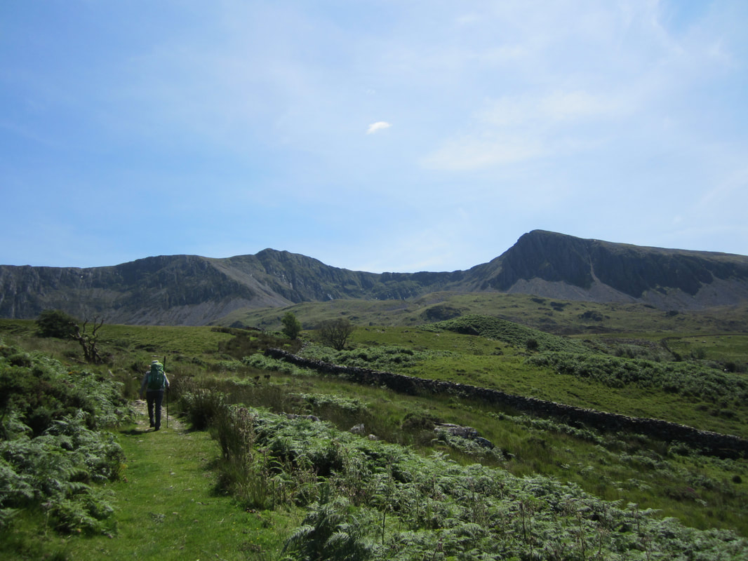 The route approaches the lake of llyn cau before. Blog