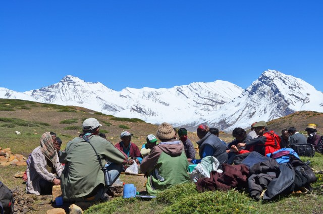 Lively discussions between villagers and the SLT team at a community meeting outside a village in Spiti.