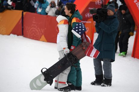 Scotty James of Australia (right) congratulates Shaun White of the USA at the completion of the Men's Snowboard Halfpipe Final, at Phoenix Snow Park during the PyeongChang 2018 Winter Olympic Games, in PyeongChang, South Korea, Wednesday, February 14, 2018. (AAP Image/Dan Himbrechts)