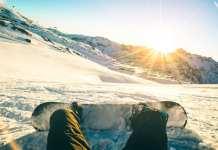 snowboarder sitting down