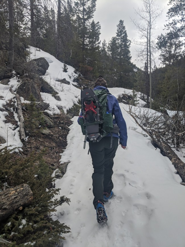 Yaktrax reviews: woman climbing hill will Yaktrax traction devices