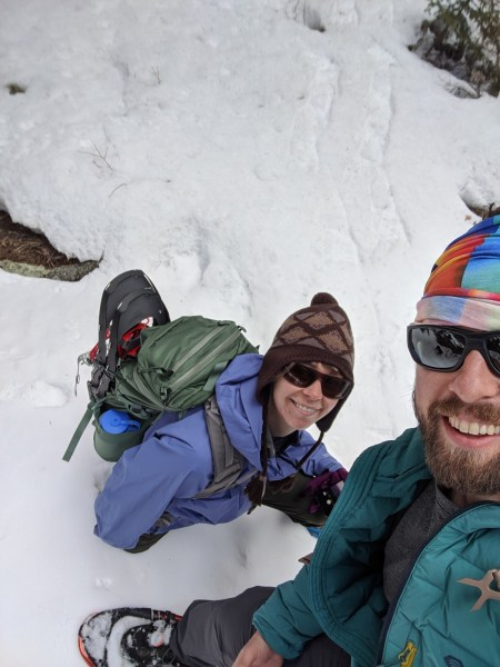selfie of man and woman on snowshoe hike