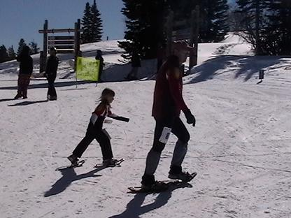 dad and child snowshoeing