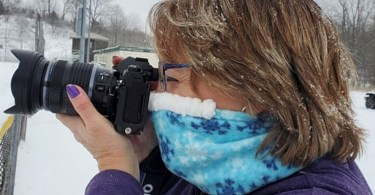 woman wearing Cozy Noze while taking a photo