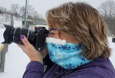 woman wearing Cozy Noze while taking a photo
