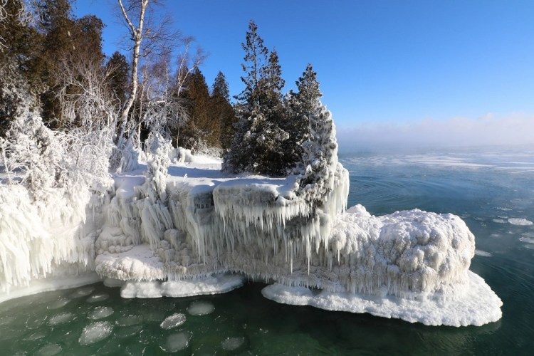 winter activities Door County: frozen waterfalls in Cave Point County Park