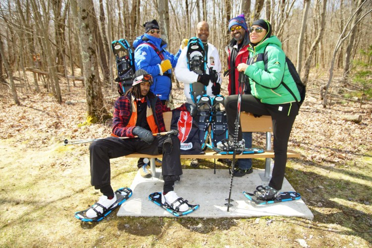 NBS snowshoers posing for photo before snowshoeing