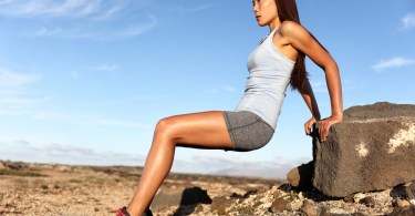 woman using rock to exercise
