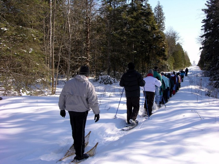 winter activities in Door County: group of snowshoers on a tour at Ridges Sanctuary