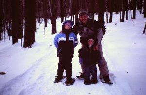 grandfather with grandchildren while snowshoeing