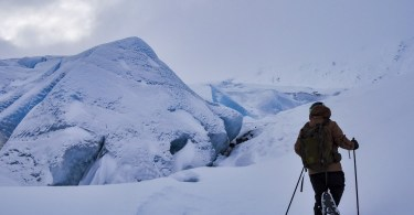 person snowshoeing near Portage Glacier, AK