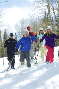"""""""I think snowshoeing is going in popularity,"""" says White Pine Touring snowshoe guide, Victoria Ritzinger. """"It's really a great opportunity for people who don't enjoy skiing, or are older, or have been injured. Even young people who are injured and cannot ski can often come snowshoeing."""" Photo courtesy of Vail Resorts."""